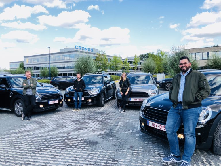 Fresh junior pointers flashing their new cars at the cronos campus in kontich posing in front of the headquarters of tothepoint it consultancy