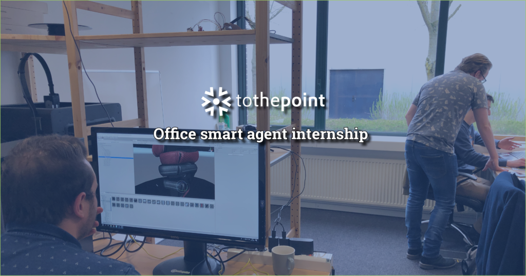 A pointer is assistent an intern at checking the code for his office smart agent as another intern is working on the Virtual Reality environment itself.
