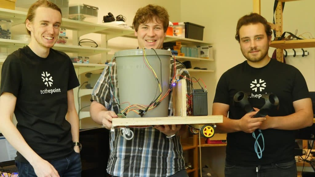 Smart Trash Management Interns Bert, Joris and Robin showcasing the working prototype of their autonomous self driving smart trashcan.